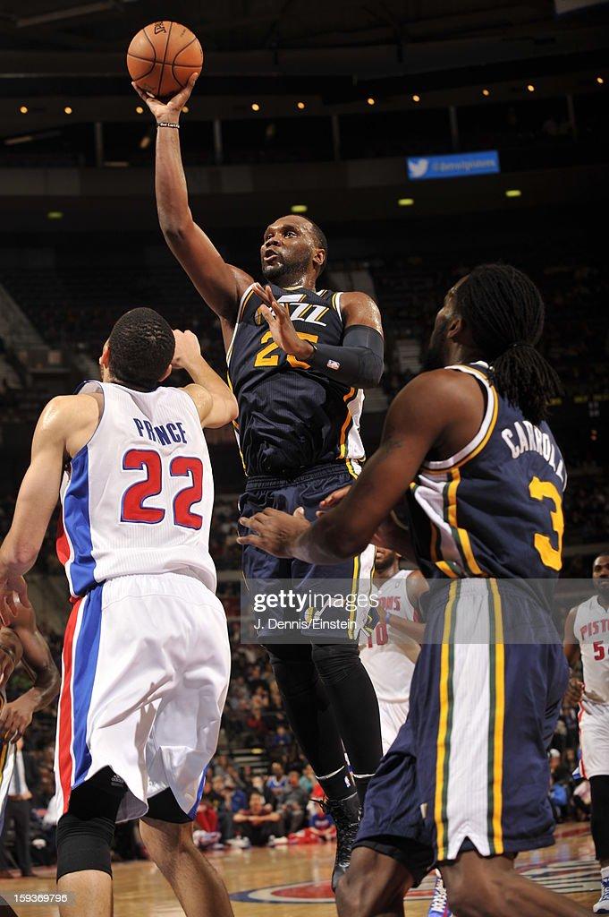 Al Jefferson #25 of the Utah Jazz shoots against Tayshaun Prince #22 of the Detroit Pistons on January 12, 2013 at The Palace of Auburn Hills in Auburn Hills, Michigan.