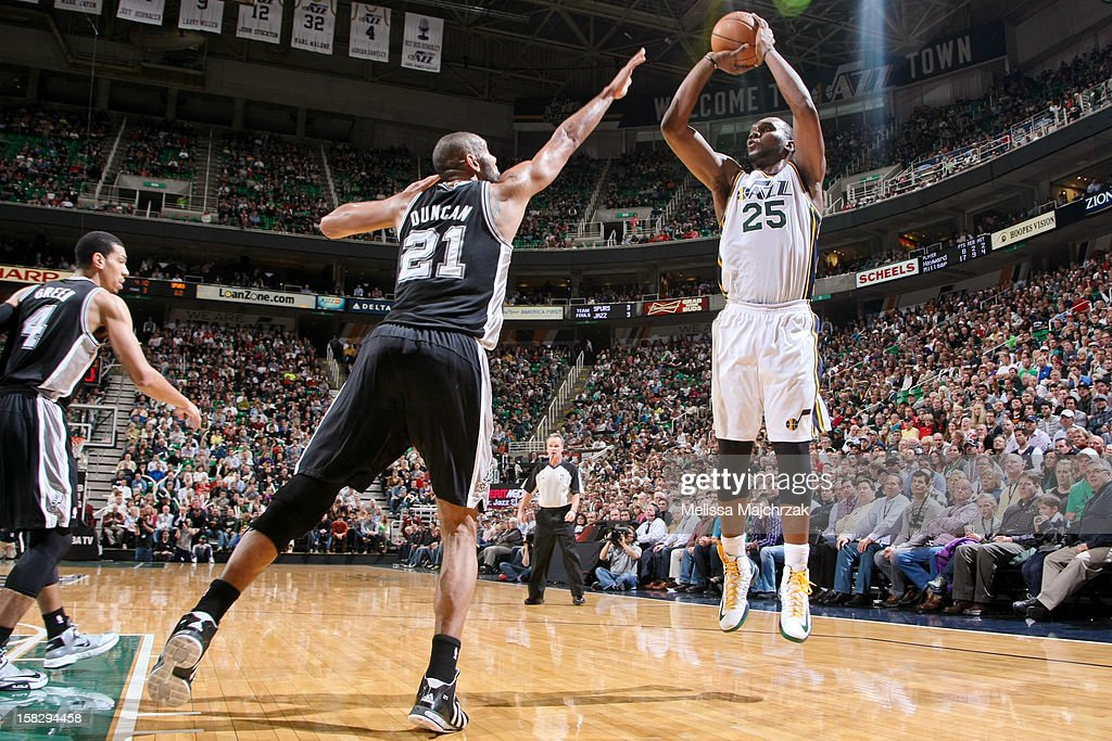 <a gi-track='captionPersonalityLinkClicked' href=/galleries/search?phrase=Al+Jefferson&family=editorial&specificpeople=201604 ng-click='$event.stopPropagation()'>Al Jefferson</a> #25 of the Utah Jazz shoots against <a gi-track='captionPersonalityLinkClicked' href=/galleries/search?phrase=Tim+Duncan&family=editorial&specificpeople=201467 ng-click='$event.stopPropagation()'>Tim Duncan</a> #21 of the San Antonio Spurs at Energy Solutions Arena on December 12, 2012 in Salt Lake City, Utah.