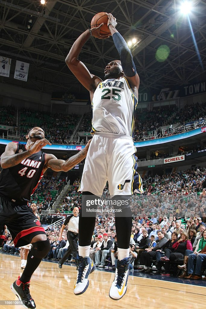 Al Jefferson #25 of the Utah Jazz shoots against Udonis Haslem #40 of the Miami Heat at Energy Solutions Arena on January 14, 2013 in Salt Lake City, Utah.