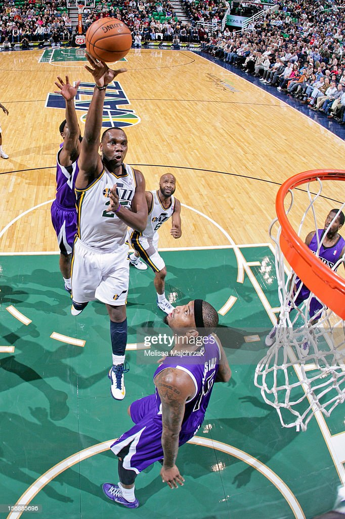 <a gi-track='captionPersonalityLinkClicked' href=/galleries/search?phrase=Al+Jefferson&family=editorial&specificpeople=201604 ng-click='$event.stopPropagation()'>Al Jefferson</a> #25 of the Utah Jazz shoots in the lane against <a gi-track='captionPersonalityLinkClicked' href=/galleries/search?phrase=DeMarcus+Cousins&family=editorial&specificpeople=5792008 ng-click='$event.stopPropagation()'>DeMarcus Cousins</a> #15 of the Sacramento Kings at Energy Solutions Arena on November 23, 2012 in Salt Lake City, Utah.