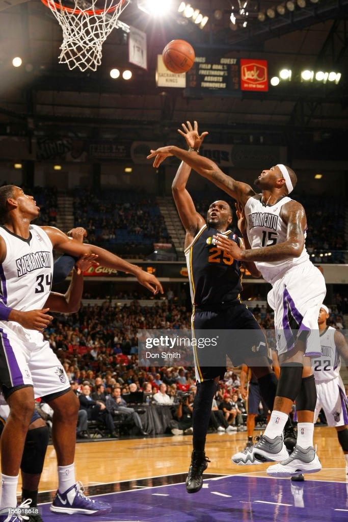 Al Jefferson #25 of the Utah Jazz shoots the ball against DeMarcus Cousins #15 of the Sacramento Kings on November 24, 2012 at Sleep Train Arena in Sacramento, California.