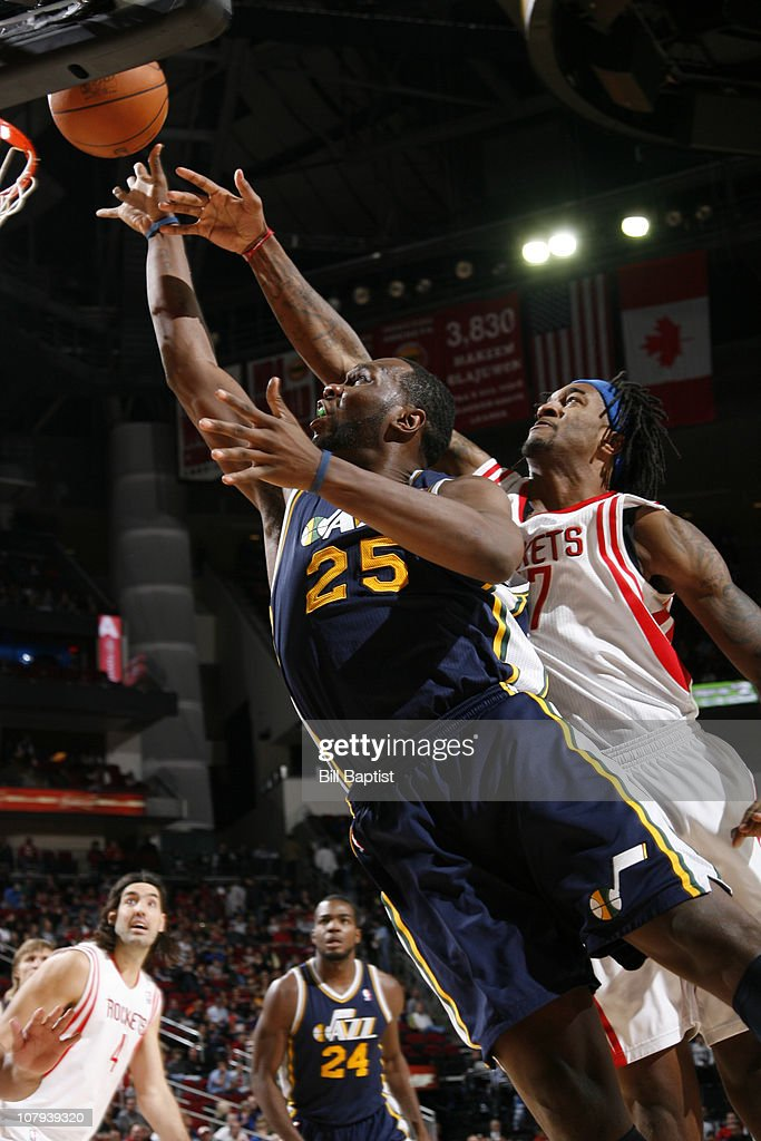 Al Jefferson #25 of the Utah Jazz shoots the ball over Jordan Hill #27 of the Houston Rockets on January 8, 2011 at the Toyota Center in Houston, Texas.