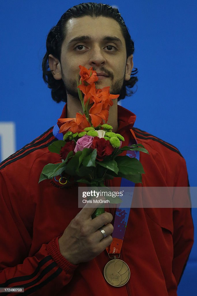 Al Kojah Omar of Syria stands on the podium after receiving his bronze medal during the victory ceremony for the Billiards, Men's Team event at Songdo Convensia on day four of the 4th Asian Indoor & Martial Arts Games on July 2, 2013 in Incheon, South Korea.