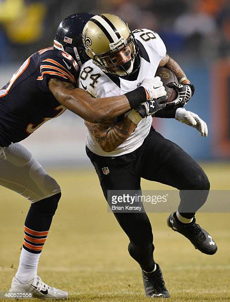 Al LouisJean of the Chicago Bears tackles Kenny Stills of the New Orleans Saints during the third quarter at Soldier Field on December 15 2014 in...
