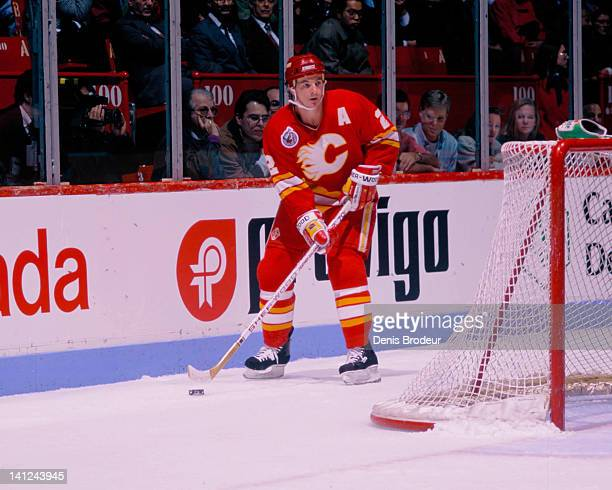 Al MacInnis of the Calgary Flames skates with the puck against the Montreal Canadiens Circa 1990 at the Montreal Forum in Montreal Quebec Canada