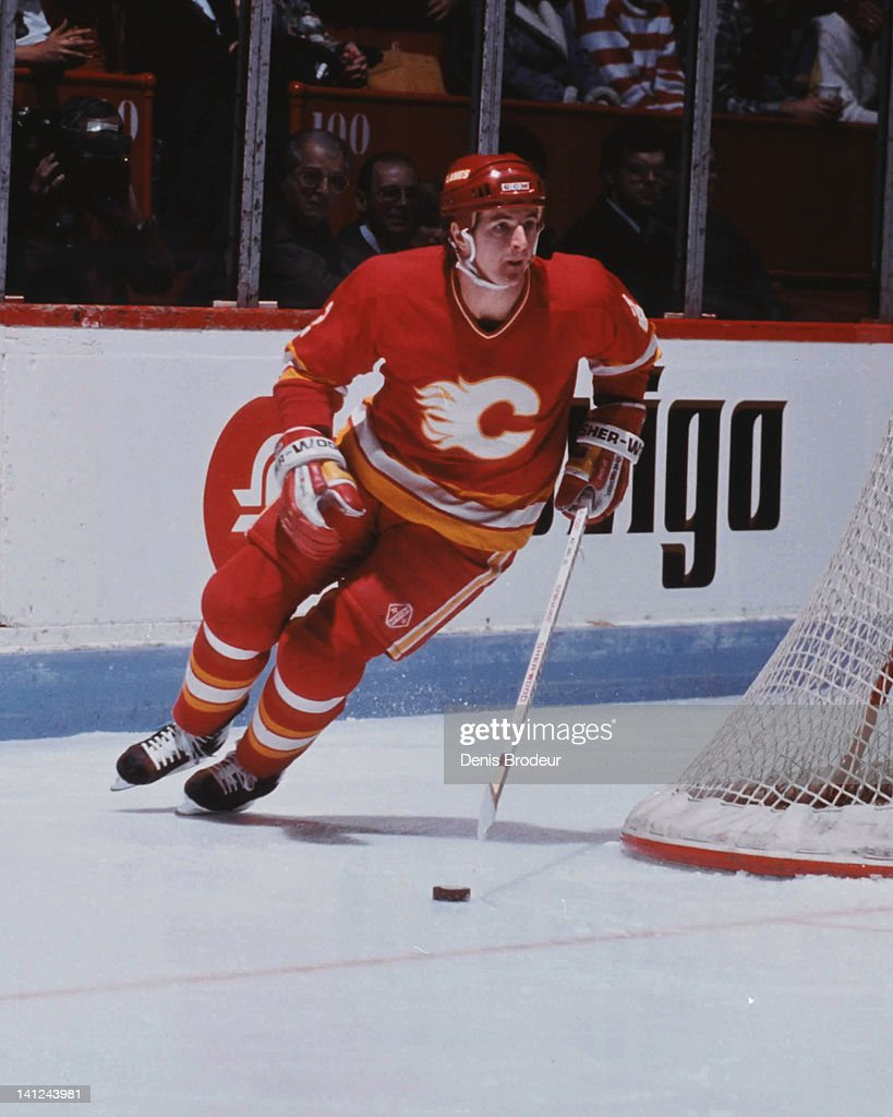Al MacInnis #2 of the Calgary Flames skates with the puck against the Montreal Canadiens Circa 1990 at the Montreal Forum in Montreal, Quebec, Canada.