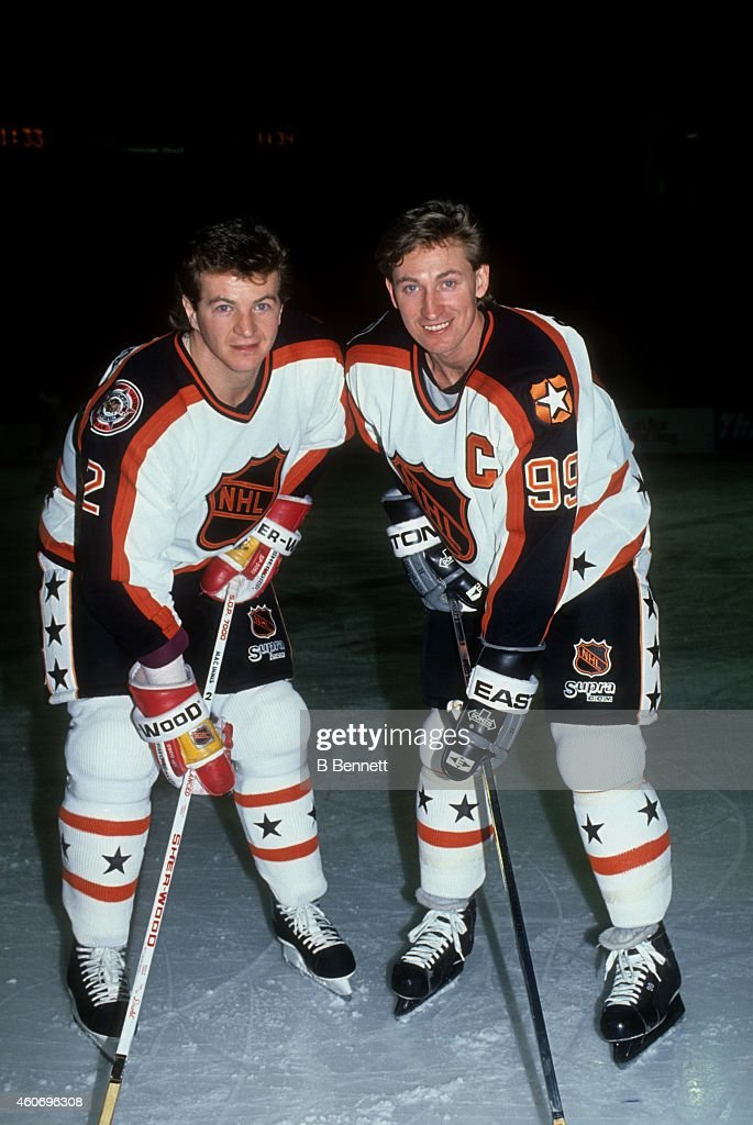 Al MacInnis #2 of the Campbell Conference and the Calgary Flames poses for a portrait with his teammate <a gi-track='captionPersonalityLinkClicked' href=/galleries/search?phrase=Wayne+Gretzky+-+Ice+Hockey+Player&family=editorial&specificpeople=157520 ng-click='$event.stopPropagation()'>Wayne Gretzky</a> #99 of the Los Angeles Kings before the 1991 42nd NHL All-Star Game against the Wales Conference on January 19, 1991 at Chicago Stadium in Chicago, Illinois. The Campbell Conference defeated the Wales Conference 11-5.