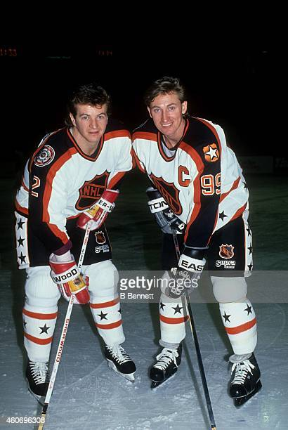 Al MacInnis of the Campbell Conference and the Calgary Flames poses for a portrait with his teammate Wayne Gretzky of the Los Angeles Kings before...