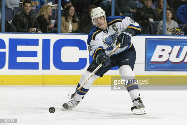 Al MacInnis of the St Louis Blues passes the puck during the NHL game against the Phoenix Coyotes at the Savvis Center on February 15 2003 in St...