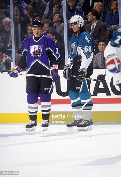 Al MacInnis of the Western Conference and the St Louis Blues stands on the ice with Jaromir Jagr of the Eastern Conference and the Pittsburgh...