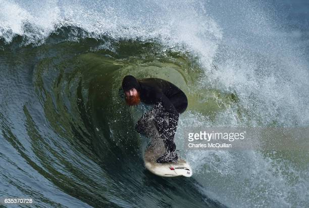 Al Mennie known as Big Red due to his six foot five stature and complexion starts a run along a barrelling wave on February 2 2017 in Portrush...