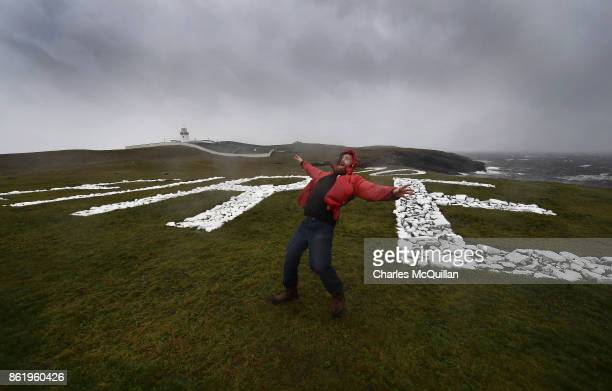 Al Mennie struggles against the wind at St John's Point lighthouse where the word Eire is spelt out on white chalk for passing aeroplanes during...