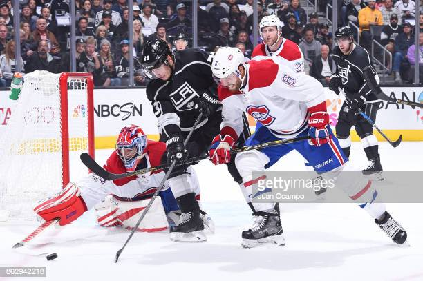Al Montoya and Shea Weber of the Montreal Canadiens battle for the puck against Dustin Brown of the Los Angeles Kings at STAPLES Center on October 18...