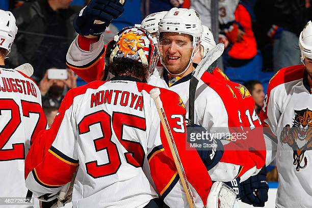 Al Montoya of the Florida Panthers is congratulated by teammate Aaron Ekblad after defeating the New York Islanders at Nassau Veterans Memorial...