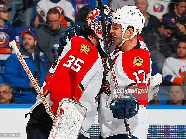 Al Montoya of the Florida Panthers is congratulated by teammate Derek MacKenzie after defeating the New York Islanders at Nassau Veterans Memorial...