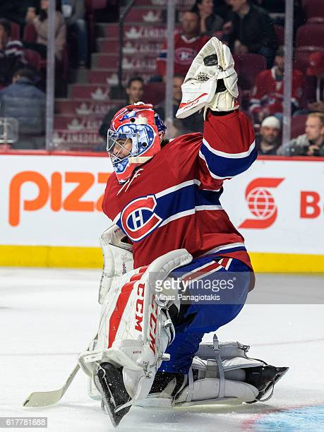 Al Montoya of the Montreal Canadiens gloves the puck during the warmup prior to the NHL game against the Arizona Coyotes at the Bell Centre on...