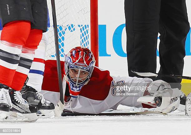 Al Montoya of the Montreal Canadiens grabs the puck late in the third period against the New Jersey Devils at the Prudential Center on January 20...