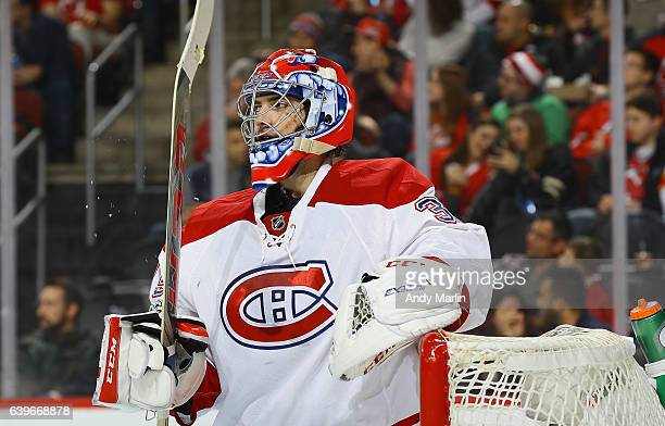 Al Montoya of the Montreal Canadiens looks on against the New Jersey Devils during the game at Prudential Center on January 20 2017 in Newark New...