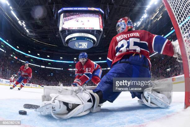 Al Montoya of the Montreal Canadiens makes a save against the Detroit Red Wings in the NHL game at the Bell Centre on March 21 2017 in Montreal...