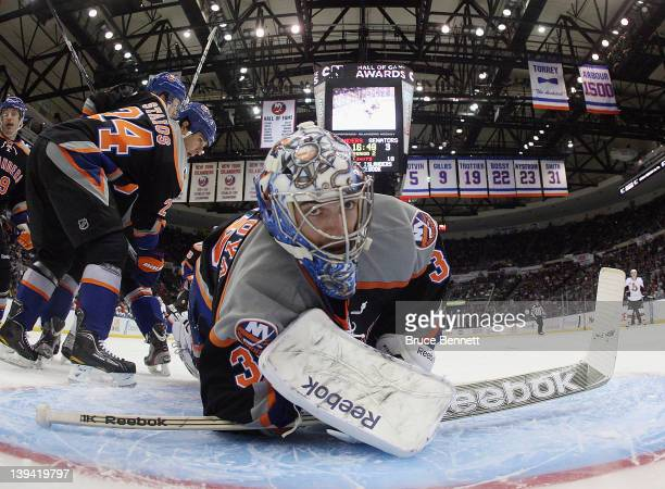 Al Montoya of the New York Islanders sprawls to make a save in the game against the Ottawa Senators at the Nassau Veterans Memorial Coliseum on...