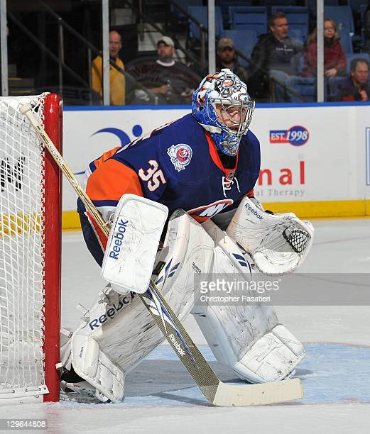 Al Montoya of the New York Islanders watches the game action during the first period against the Tampa Bay Lightning at Nassau Coliseum on October 13...