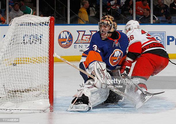 Al Montoya of the New York Islanders watches the puck go into the net on a goal by Jussi Jokinen of the Carolina Hurricanes on April 2 2011 at Nassau...