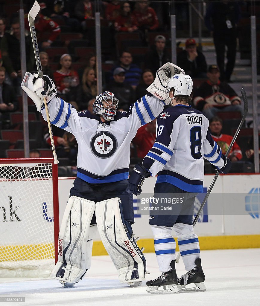 <a gi-track='captionPersonalityLinkClicked' href=/galleries/search?phrase=Al+Montoya&family=editorial&specificpeople=213916 ng-click='$event.stopPropagation()'>Al Montoya</a> #35 of the Winnipeg Jets (L) celebrates a win over the Chicago Blackhawks with teammate <a gi-track='captionPersonalityLinkClicked' href=/galleries/search?phrase=Jacob+Trouba&family=editorial&specificpeople=8050718 ng-click='$event.stopPropagation()'>Jacob Trouba</a> #8 at the United Center on January 26, 2014 in Chicago, Illinois. The Jets defeated the Blackhawks 3-1.