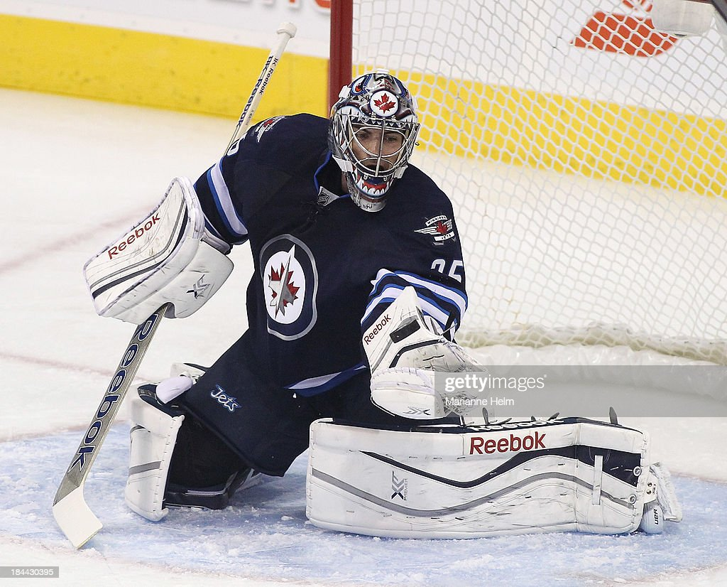 <a gi-track='captionPersonalityLinkClicked' href=/galleries/search?phrase=Al+Montoya&family=editorial&specificpeople=213916 ng-click='$event.stopPropagation()'>Al Montoya</a> #35 of the Winnipeg Jets grabs the puck in first period action of an NHL game against the New Jersey Devils at the MTS Centre on October 13, 2013 in Winnipeg, Manitoba, Canada.
