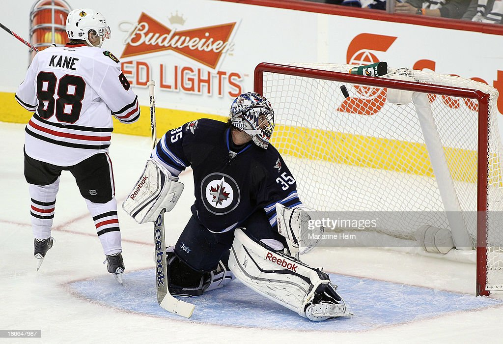 <a gi-track='captionPersonalityLinkClicked' href=/galleries/search?phrase=Al+Montoya&family=editorial&specificpeople=213916 ng-click='$event.stopPropagation()'>Al Montoya</a> #35 of the Winnipeg Jets looks back as the puck hits the post as Patrick Kane #88 of the Chicago Blackhawks attempts a penalty shot in third period action in an NHL game at the MTS Centre on November 2, 2013 in Winnipeg, Manitoba, Canada.