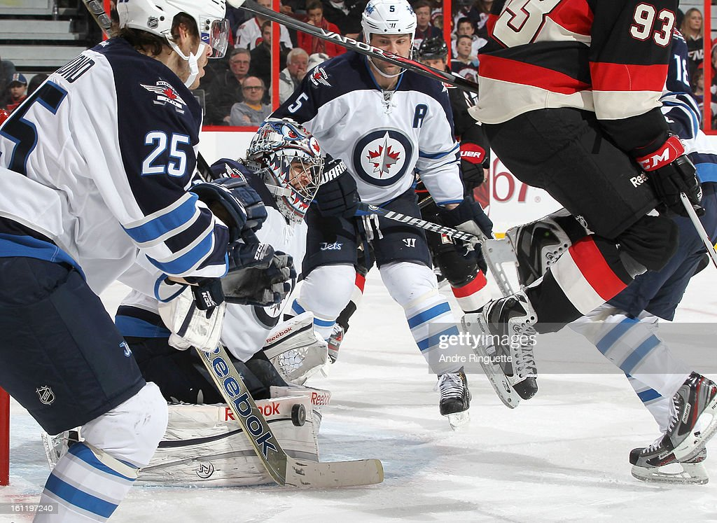 <a gi-track='captionPersonalityLinkClicked' href=/galleries/search?phrase=Al+Montoya&family=editorial&specificpeople=213916 ng-click='$event.stopPropagation()'>Al Montoya</a> #35 of the Winnipeg Jets makes a pad save as <a gi-track='captionPersonalityLinkClicked' href=/galleries/search?phrase=Mika+Zibanejad&family=editorial&specificpeople=7832310 ng-click='$event.stopPropagation()'>Mika Zibanejad</a> #93 of the Ottawa Senators jumps to avoid the shot on February 9, 2013 at Scotiabank Place in Ottawa, Ontario, Canada.