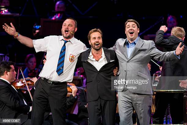 Al Murray Alfie Boe and Jason Manford perform at the Symfunny fundraiser in aid of Parkinson's UK at Royal Albert Hall on June 4 2014 in London...