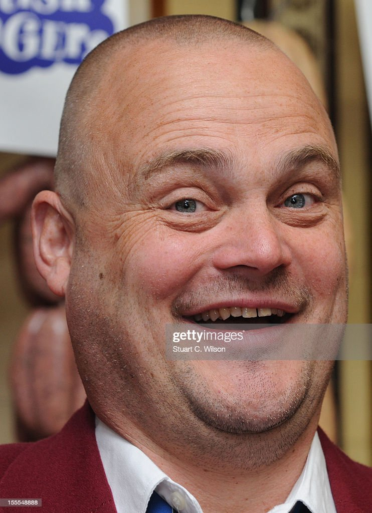 Al Murray attends a photocall to launch British Sausage Week at Allen's of Mayfair, London's oldest butcher shop on November 5, 2012 in London, England.