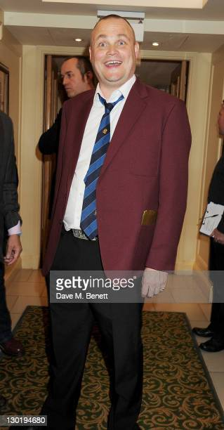 Al Murray poses in the press room at the Q Awards 2011 held at The Grosvenor House Hotel on October 24 2011 in London England