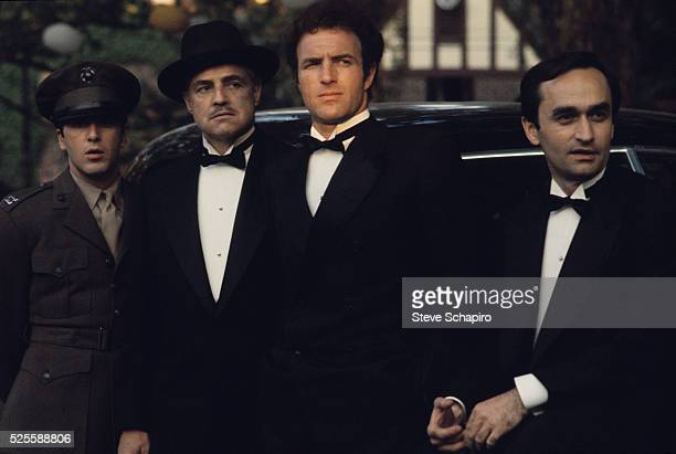 Al Pacino Marlon Brando James Caan and John Cazale stand in the 1972 movie The Godfather