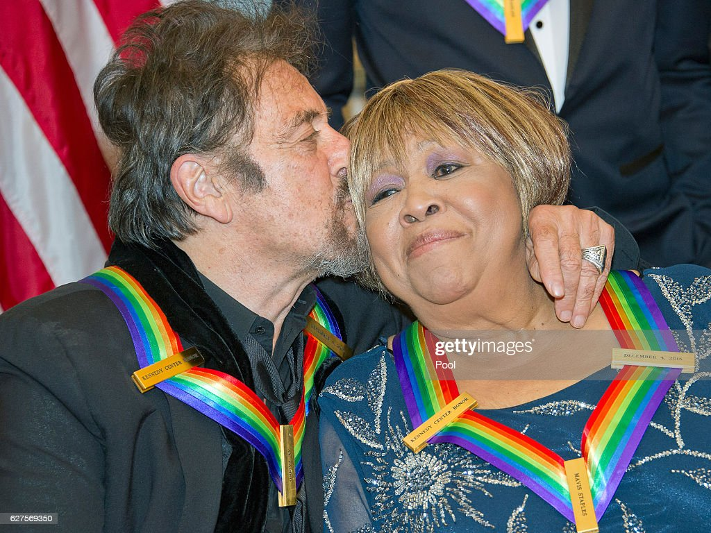 Al Pacino one of the five recipients of the 39th Annual Kennedy Center Honors kisses another recipient, gospel and blues singer Mavis Staples as they prepare to pose for a group photo following a dinner at the U.S. Department of State in Washington, D.C. on Saturday, December 3, 2016. The 2016 honorees are: Argentine pianist Martha Argerich; rock band the Eagles; screen and stage actor Al Pacino; gospel and blues singer Mavis Staples; and musician James Taylor. From left to right back row: Joe Walsh, Don Henley, and Timothy B. Schmidt of the rock band 'The Eagles.' Front row, left to right: Al Pacino, Mavis Staples, Martha Argerich, and James Taylor.