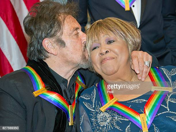 Al Pacino one of the five recipients of the 39th Annual Kennedy Center Honors kisses another recipient gospel and blues singer Mavis Staples as they...
