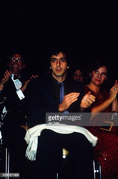 Al Pacino seated in an audience applauding circa 1970 New York