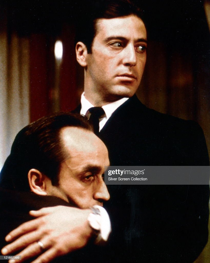 Al Pacino US actor embracing John Cazale US actor in a publicity still issued for the film 'The Godfather Part II' 1974 The mafia drama directed by...