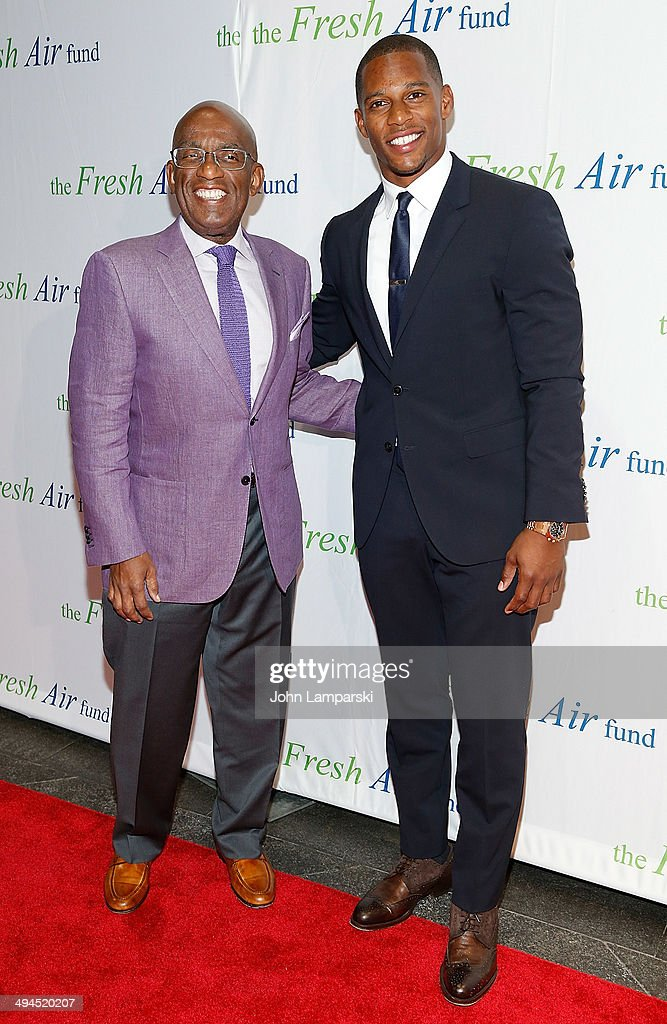Al Roker and Victor Cruz attends the 2014 Fresh Air Fund Honoring Our American Hero at Pier Sixty at Chelsea Piers on May 29, 2014 in New York City.