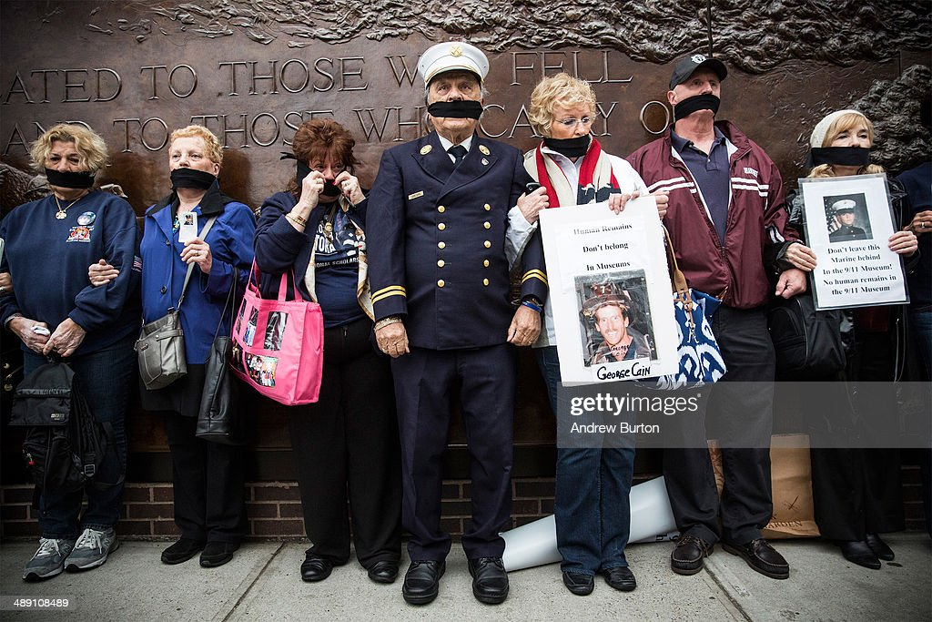 Al Santora (C), father of firefighter Christopher Santora, a victim of the September 11, 2001 attack, and other victim's family members protest the decision by city officials to keep unidentified human remains of the 9-11 victims at the 9-11 Museum at the World Trade Center site, on May 10, 2014 in New York City. The decision by city officials to keep the remains at the museum until they are able to be identified has drawn both support and criticism by families of victims. The remains were moved early this morning from the medical examiner's repository to the 9-11 Museum.