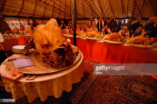 Al Saud princes enjoy a feast during an annual meeting of the royal family on January 2003 in Om Rogheiba Saudi Arabia In a richly decorated tent...
