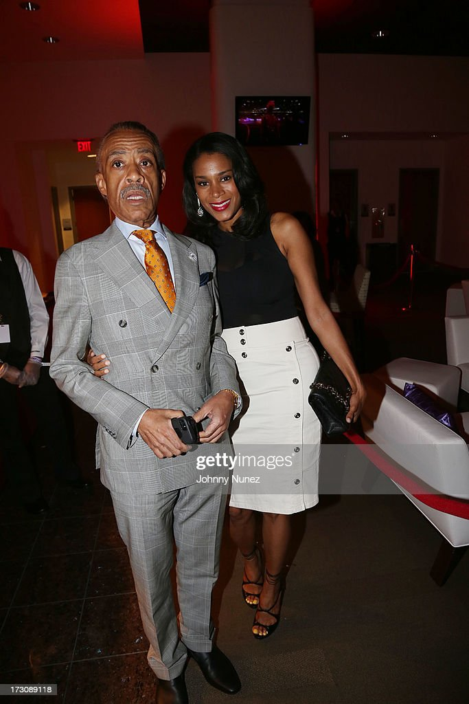 Al Sharpton and Aisha McShaw attend the 2013 Essence Festival at the Mercedes-Benz Superdome on July 6, 2013 in New Orleans, Louisiana.