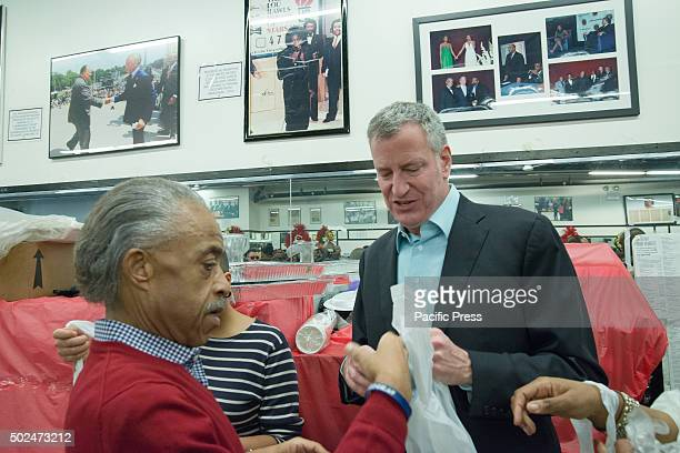 Al Sharpton and Bill de Blasio don plastic aprons as thjey prepare to serve food to the less fortunate New York City Mayor Bill de Blasio and his...