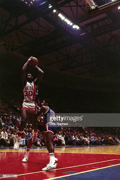 Al Skinner of the New Jersey Nets goes up for a shot against Mo Layton of the New York Knicks during a game played in 1976 at the Nassau Coliseum in...