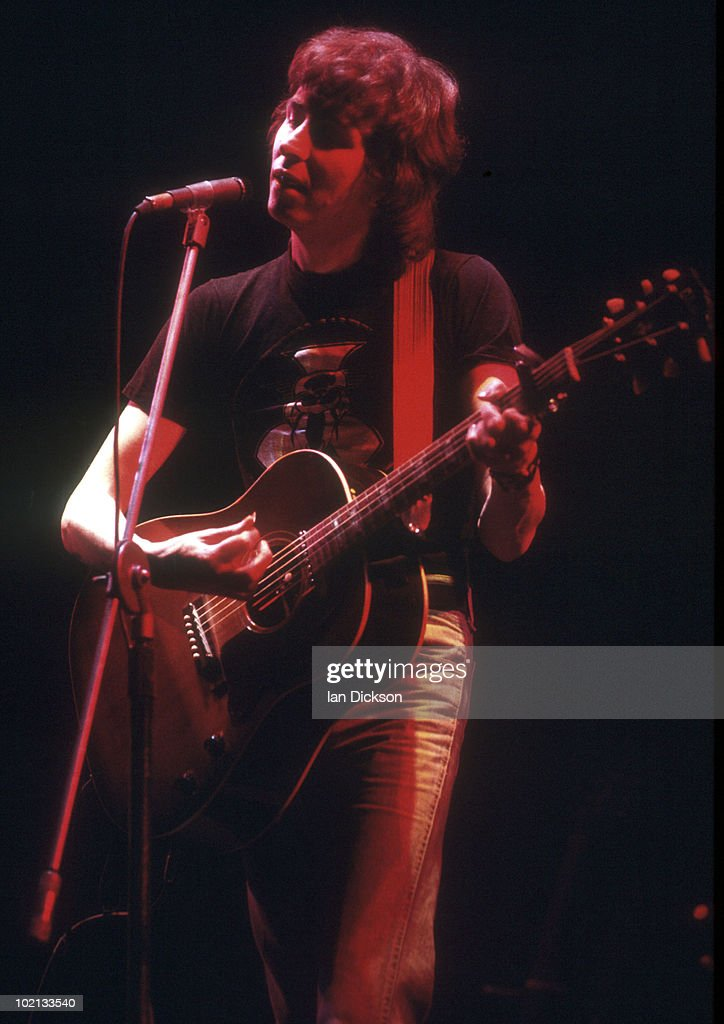 Al Stewart performs live on stage at Hammersmith Odeon in London in November 1976