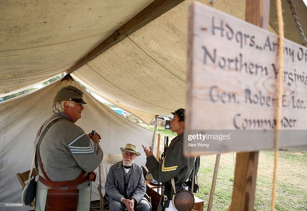 Al Stone (C), who portrays General Robert E. Lee, talks to Confederate infantry re-enactors Sue Milewski (R) and Robert Mergel (L) during an event to mark the 150th anniversary of the Battle of Antietam September 15, 2012 in Sharpsburg, Maryland. The Battle of Antietam was fought on September 17, 1862 and was the bloodiest battle in American history with more than 23,000 men killed, wounded, and missing in one single day. It marked the end of General Robert E. Lee's first invasion of the North and led to Abraham Lincoln's issuance of the Emancipation Proclamation.