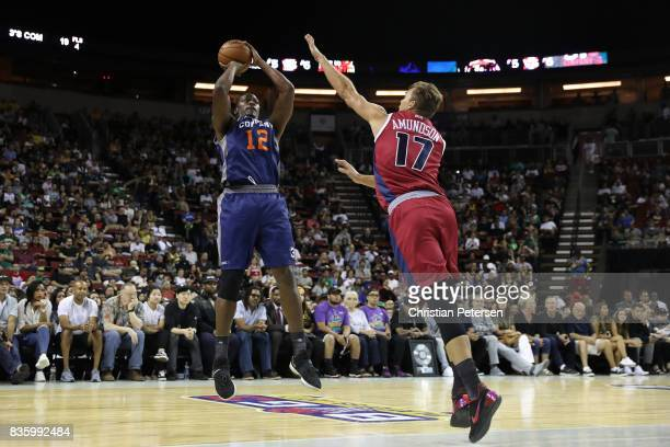 Al Thornton of the 3's Company shoots the ball in front of defender Lou Amundson of the TriState in week nine of the BIG3 threeonthree basketball...