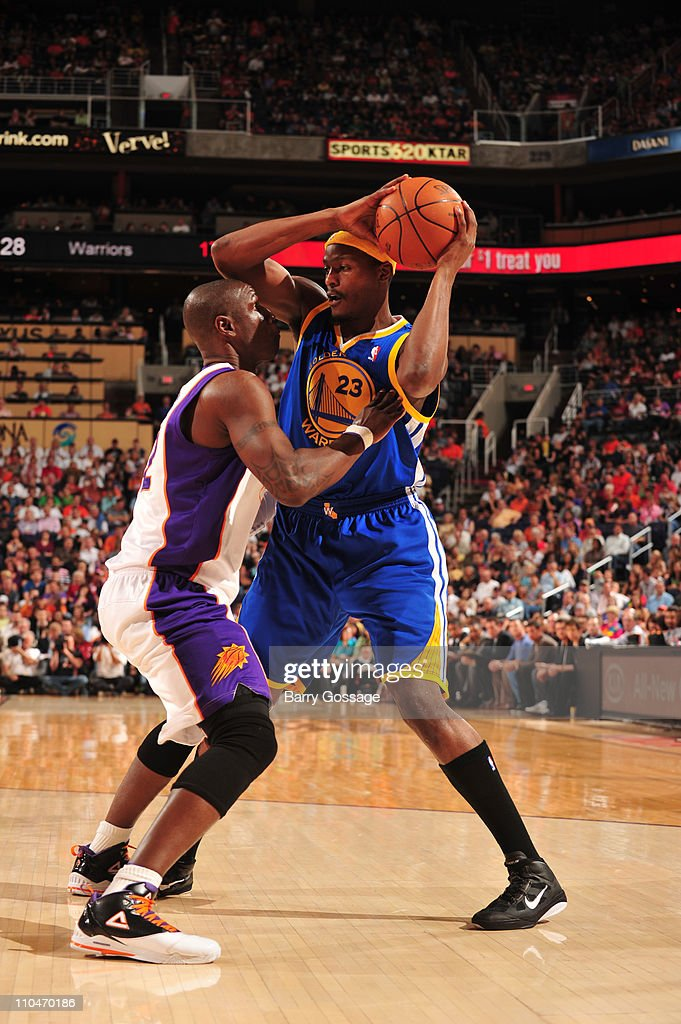 <a gi-track='captionPersonalityLinkClicked' href=/galleries/search?phrase=Al+Thornton&family=editorial&specificpeople=816211 ng-click='$event.stopPropagation()'>Al Thornton</a> #23 of the Golden State Warriors is guarded by <a gi-track='captionPersonalityLinkClicked' href=/galleries/search?phrase=Mickael+Pietrus&family=editorial&specificpeople=202910 ng-click='$event.stopPropagation()'>Mickael Pietrus</a> #12 of the Phoenix Suns in an NBA game played on March 18, 2011 at U.S. Airways Center in Phoenix, Arizona.