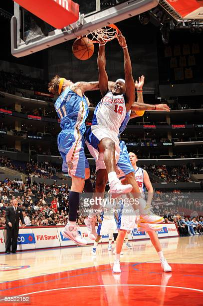 Al Thornton of the Los Angeles Clippers dunks against Chris Andersen of the Denver Nuggets at Staples Center on October 31 2008 in Los Angeles...