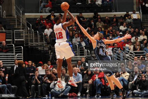 Al Thornton of the Los Angeles Clippers has his shot contested by Andrei Kirilenko of the Utah Jazz at Staples Center on November 3 2008 in Los...